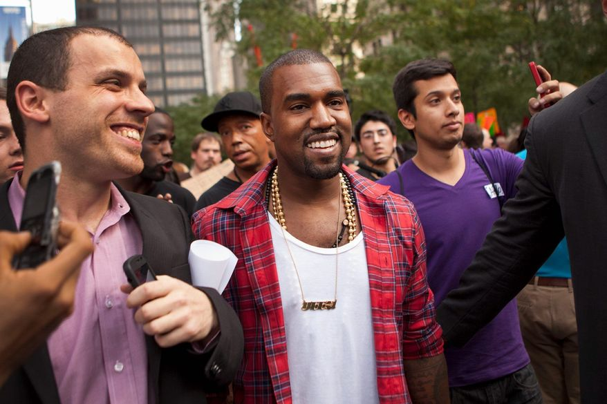 Kanye West is among the rappers who have visited the Occupy Wall Street protests in New York City's Zuccotti Park. Others include Talib Kweli and Lupe Fiasco. (Associated Press)