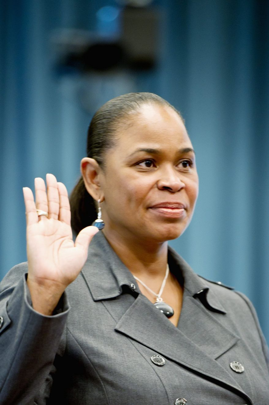 Jennifer A.J. Greene swears in before giving testimony during a hearing to make her the official director of the agency that handles 911 emergency calls and 311 service requests. (Andrew Harnik/The Washington Times)