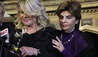 Sharon Bialek (left) of the Chicago area, with her lawyer Gloria Allred, prepares to address a news conference at the Friars Club in New York on Monday, Nov. 7, 2011. Ms. Bialek accused Republican presidential contender Herman Cain of making an unwanted sexual advance against her more than a decade ago. (AP Photo/Richard Drew)