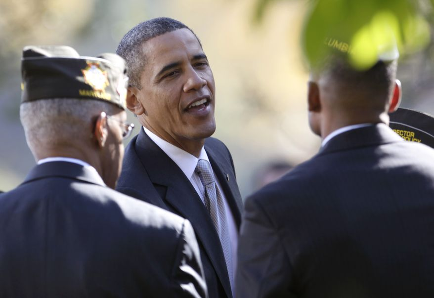 President Obama greets veterans after talking about the American Jobs Act on Monday, Nov. 7, 2011, in the Rose Garden of the White House in Washington. (AP Photo/Carolyn Kaster)