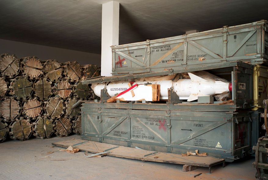 """The top U.N. envoy to Libya said in late 2011 that some weapons depots in Libya had still not been secured properly, and that much had """"already gone missing."""" An open crate at the same facility reveals a rocket inside. (Associated Press)"""