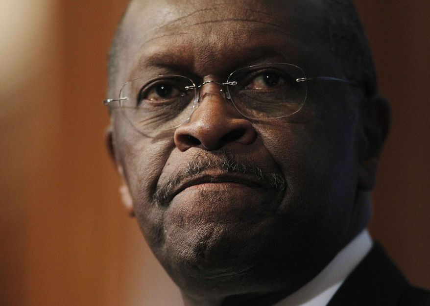 **FILE** Republican presidential candidate Herman Cain answers questions Oct. 31, 2011, at the National Press Club in Washington about sexual harassment allegations. (Associated Press)