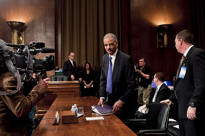 U.S. Attorney General Eric H. Holder Jr. takes his seat before testifying to the Senate Judiciary Committee in Washington on Tuesday, Nov. 8, 2011. Mr. Holder was scrutinized for his role in allowing, or at least not preventing, a controversial tactic that allowed illegal guns to be smuggled into Mexico. (T.J. Kirkpatrick/The Washington Times)