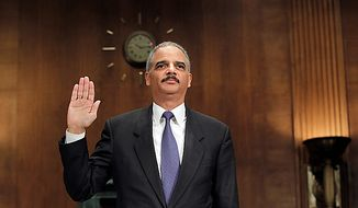 "Attorney General Eric H. Holder Jr. is sworn in on Capitol Hill in Washington on Tuesday, Nov. 8, 2011, before testifying before a Senate Judiciary Committee hearing on the arms-trafficking investigation of ""Operation Fast and Furious."" (AP Photo/J. Scott Applewhite)"