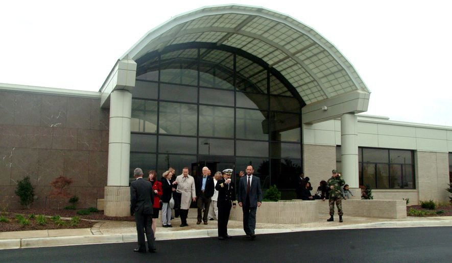 ** FILE ** Visitors leave the Charles C. Carson Center for Mortuary Affairs at Dover Air Force Base in Delaware after opening ceremonies in October 2003. (AP Photo/Dee Marvin, File)