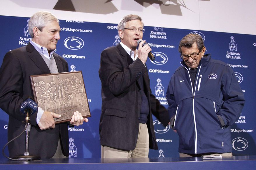 ** FILE ** Penn State President Graham Spanier (left) and Athletic Director Tim Curley (center) present head football coach Joe Paterno with a plaque commemorating his 409th collegiate win after an NCAA college football game against Illinois in State College, Pa., on Saturday, Oct. 29, 2011. (AP Photo/Gene J. Puskar, File)