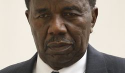 Sen. Ulysses Currie, Prince George's Democrat, leaves the U.S. District Courthouse in Baltimore, Thursday, Oct. 13, 2011, after a federal bribery case against him finished for the day. (AP Photo/Patrick Semansky)