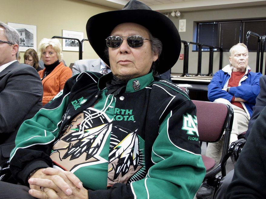 Samuel Seaboy, of Mandan, N.D., listens to testimony on Monday at the North Dakota Capitol in Bismarck about legislation that would allow the University of North Dakota to drop its Fighting Sioux nickname and an American Indian head logo. Mr. Seaboy said he opposed the bill. (Associated Press)