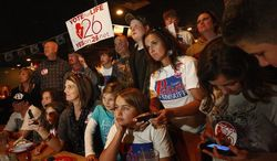 """Supporters of Mississippi's Amendment 26 watch the results of the """"personhood"""" initiative Tuesday in Southaven, Miss. The measure was defeated by a wide margin. (Associated Press)"""
