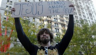 "Will Portal, of Suffolk County, N.Y., expresses his views Wednesday at the Occupy Wall Street encampment at Zuccotti Park in New York. Global Language Monitor has selected ""occupy"" as its ""top word of 2011."" Associated Press"