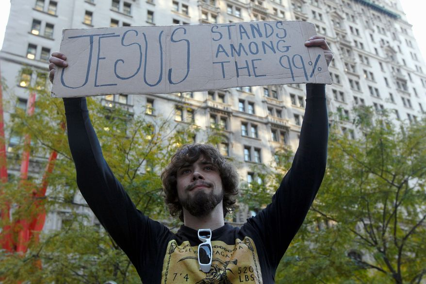 """Will Portal, of Suffolk County, N.Y., expresses his views Wednesday at the Occupy Wall Street encampment at Zuccotti Park in New York. Global Language Monitor has selected """"occupy"""" as its """"top word of 2011."""" Associated Press"""