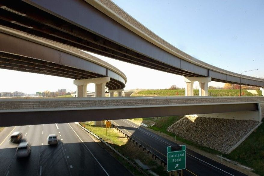 Workers are putting the final touches on the Maryland Intercounty Connector (ICC) extension into Prince George's County. The next 10.4 mile section of the roadway is slated to open Nov. 22. Officials hope the project will give thousands more motorists better access to their jobs and other destinations. (Andrew Harnik/The Washington Times)