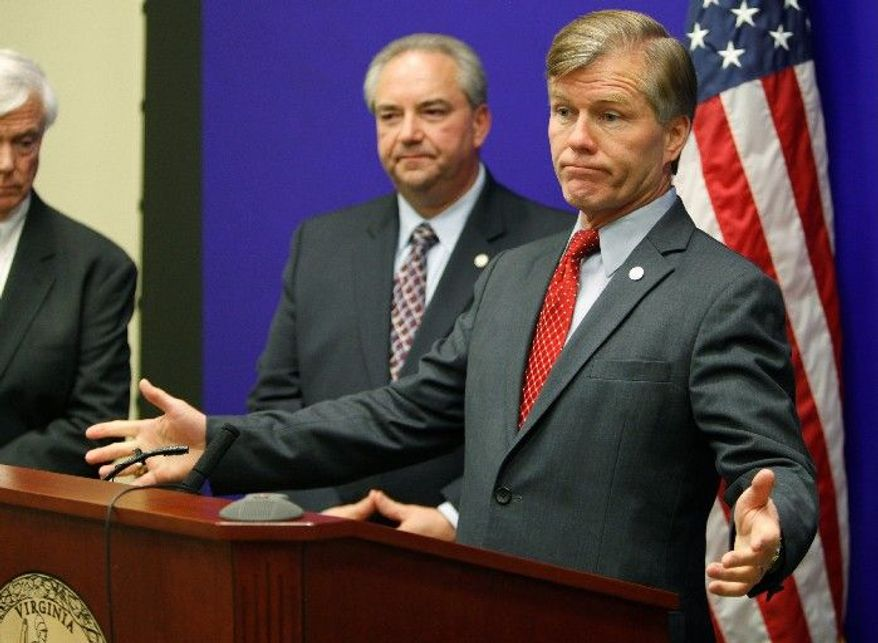 Virginia Gov. Bob McDonnell discusses election results at the Capitol in Richmond on Wednesday. Lt. Gov. Bill Bolling looks on. (Associated Press)