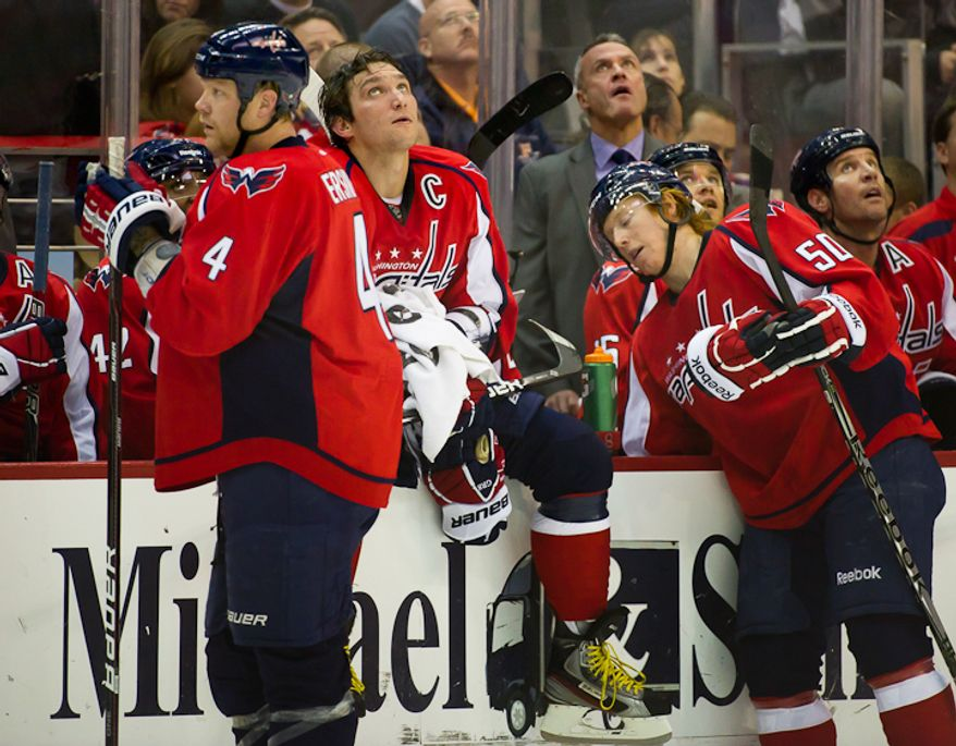 Washington Capitals' John Erskine, Alex Ovechkin and Cody Eakin rest near the bench while playing the Dallas Stars during the 2nd period at the Verizon Center in Washington, DC. Tuesday, November 8, 2011. (Andrew Harnik / The Washington Times)