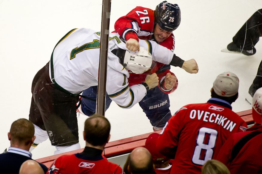 Matt Hendricks (26) of the Washington Capitals and Jake Dowell (11) of the Dallas Stars gets into a fight during the 3rd period at the Verizon Center in Washington, DC. Tuesday, November 8, 2011. (Andrew Harnik / The Washington Times)