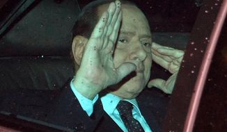 Italian Premier Silvio Berlusoni waves to journalists as he leaves the Quirinale presidential palace, after meeting with Italian President Giorgio Napolitano, in Rome, Tuesday, Nov. 8, 2011. (AP Photo/Roberto Monaldo, LaPresse)