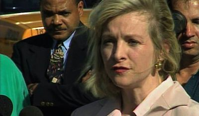** FILE ** This March 2000 image from video shows then-Immigration and Naturalization Service spokesperson Karen Kraushaar at a news conference in Miami regarding Elian Gonzalez. The Associated Press has chosen to publish Kraushaar's name, after independently confirming she was one of the accusers who filed sexual harassment complaints against Herman Cain when she and Cain worked at a restaurant trade group. (AP Photo/APTN)