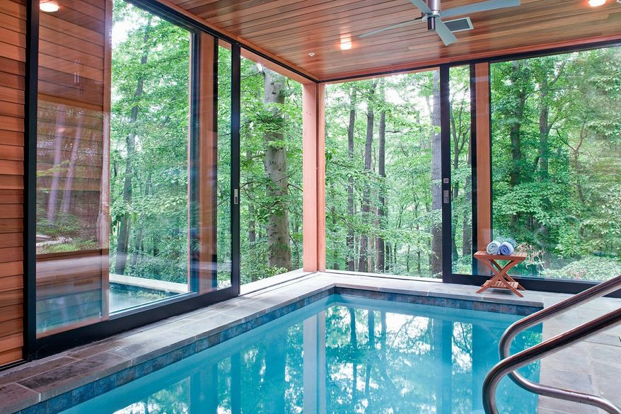 "Photo by James Ray Spahn An indoor swimming pool can be attractive this time of year, but homeowners must be sure the space has adequate ventilation and insulation so the ""whole house doesn't smell like chlorine,"" architect Jim Rill said."