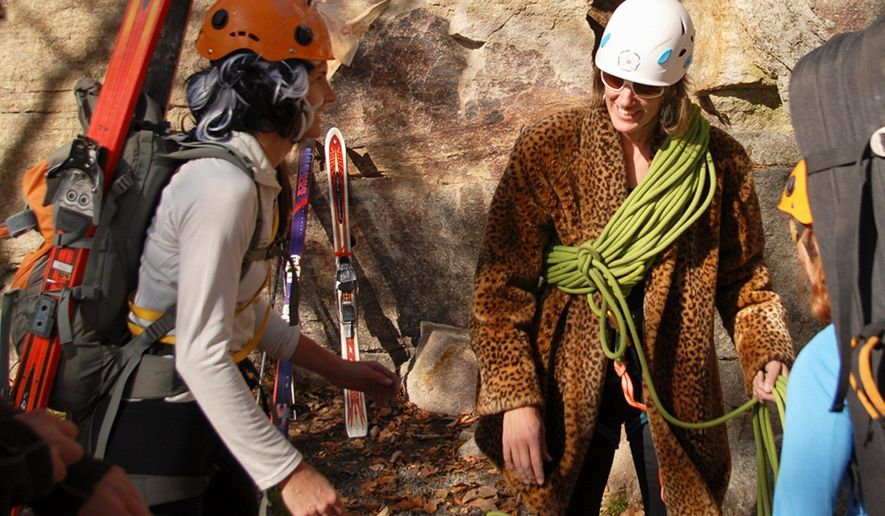 In this photo taken Oct. 28, 2011 and released by Ascent Services Worldwide LLC, Margaret Wheeler, center, president of the American Mountain Guides Association, and executive director Betsy Winter, left, prepare for an event in Guide's Olympics during the association's annual conference at the Shawangunk climbing area in New Paltz, N.Y. (AP Photo/Ascent Services Worldwide LLC, Joe Lentini)