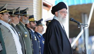 Ayatollah Ali Khamenei, Iran's supreme leader, warned Israel and the United States on Thursday to expect military response if Iran's nuclear facilities are attacked. (Associated Press)