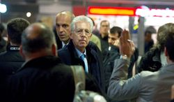 """Senator Mario Monti, waiting for his wife at Rome's Termini station Thursday, is widely considered to be the top choice for the Italian premiership, now that Silvio Berlusconi has pledged to resign soon. Mr. Monti met with President Giorgio Napolitano on Thursday night in what his office described as a """"courtesy visit."""" (Associated Press)"""