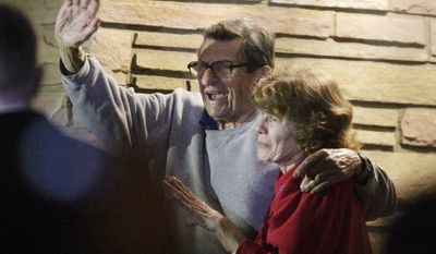 Joe Paterno and his, wife, Susan, stand on their porch to thank supporters gathered outside their home after John P. Surma, chairman and chief executive officer of the Penn State Board of Trustees, announced the firing of Paterno as head football coach and university president Graham Spanier amid the growing furor over how the school handled sex abuse allegations against an assistant coach, Wednesday, Nov. 9, 2011, in State College, Pa. (AP Photo/Gene J. Puskar)