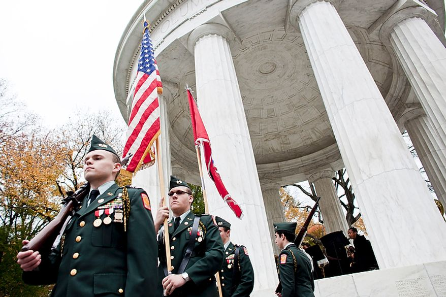Alexander Hubichi, from left, Matthew Cranford, Thomas Shedlick, and Matthew Shipley, Army JROTC cadets from St. John's College High School, carry the colors for a rededication ceremony following renovations of the District of Columbia WWI Memorial in Washington, D.C. on Nov. 10, 2011.(T.J. Kirkpatrick/ The Washington Times)