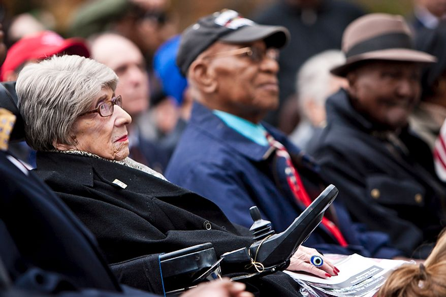 Alyce Dixon, left, a 104-year-old District resident who served in a military post office in France during WWII, attends a rededication ceremony following renovations of the District of Columbia WWI Memorial in Washington, D.C. on Nov. 10, 2011.