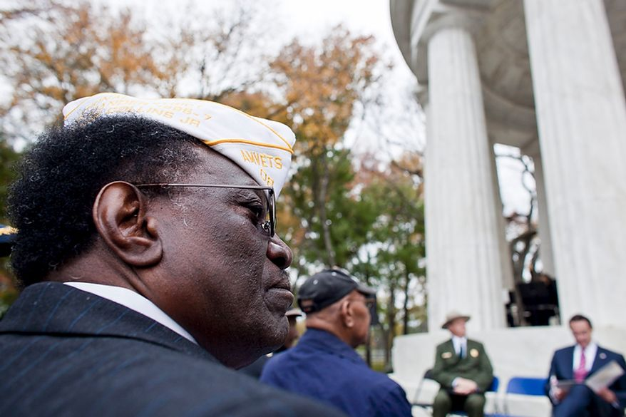 Jonnie Collins, of Alexandria, Va., a retired Army Sergeant 1st Class who serving in two tours in Vietnam, listens to a speaker at a rededication ceremony following renovations of the District of Columbia WWI Memorial in Washington, D.C. on Nov. 10, 2011.(T.J. Kirkpatrick/ The Washington Times)