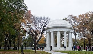 Pedestrians, veterans and members of the media walk around the grounds of the newly renovated District of Columbia WWI Memorial after a rededication ceremony in Washington, D.C. on Nov. 10, 2011.