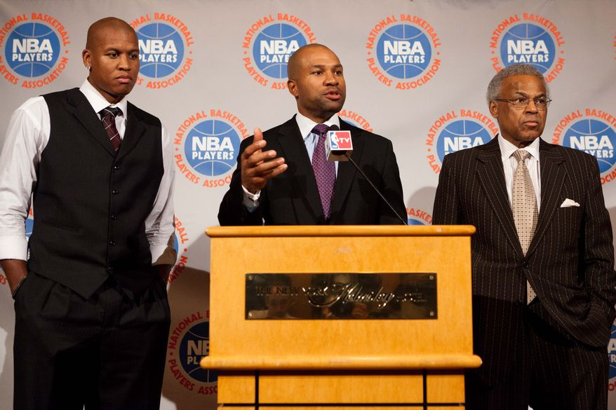National Basketball Association Players Association president Derek Fisher, center, speaks alongside Maurice Evans, left, and Billy Hunter, right, during a news conference after a marathon meeting with owners, Thursday, Nov. 10, 2011, in New York. Although no agreements have been reached, the two sides will meet again Thursday at noon in an effort to save what remains of the season after a protracted labor dispute engulfed the league. (AP Photo/John Minchillo)