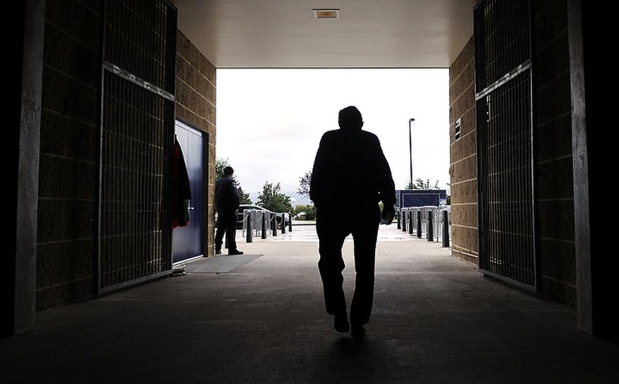 In this Oct. 5, 2010, file photo, Penn State coach Joe Paterno leaves Beaver Stadium after his weekly NCAA college football news conference in State College, Pa. Every Tuesday during the fall, Paterno ambled into the media room at Beaver Stadium, settled into his seat and held court. (AP Photo/Pat Little, File)