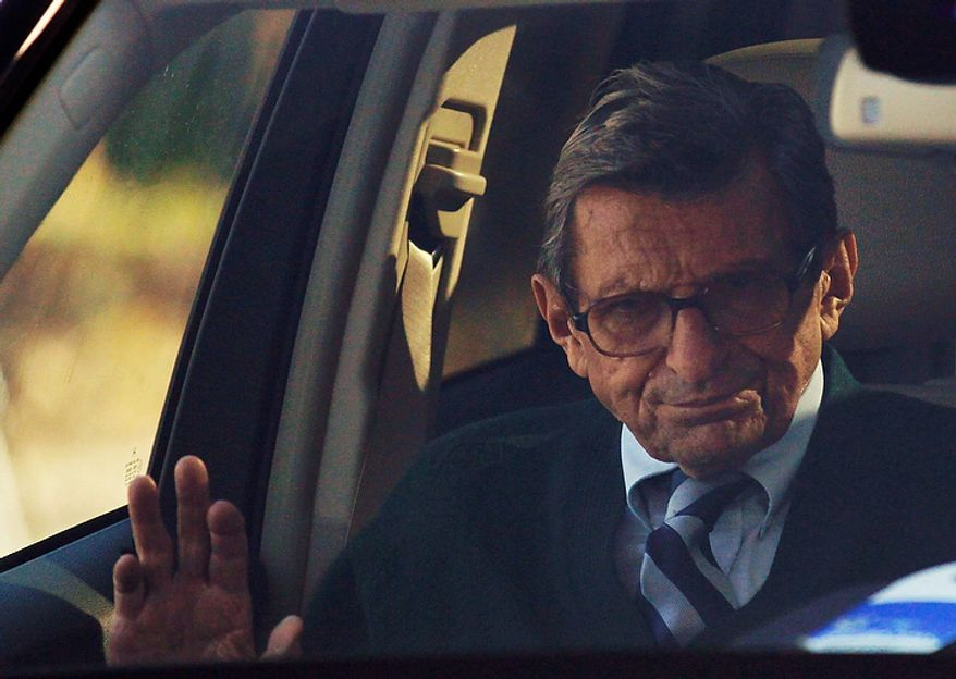 Penn State football coach Joe Paterno arrives home on Wednesday, Nov. 9, 2011, in State College, Pa. Paterno has decided to retire at the end of the season, his long career brought down by his failure to do more about an allegation of child sex abuse against a former assistant. (AP Photo/Matt Rourke)