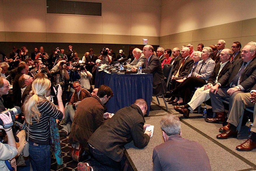 John Surma (foreground at table), vice chairman of the Penn State board of trustees, announces the firing of university President Graham Spanier and football coach Joe Paterno in State College, Pa., on Wednesday, Nov. 9, 2011. (AP Photo/Gene J. Puskar)