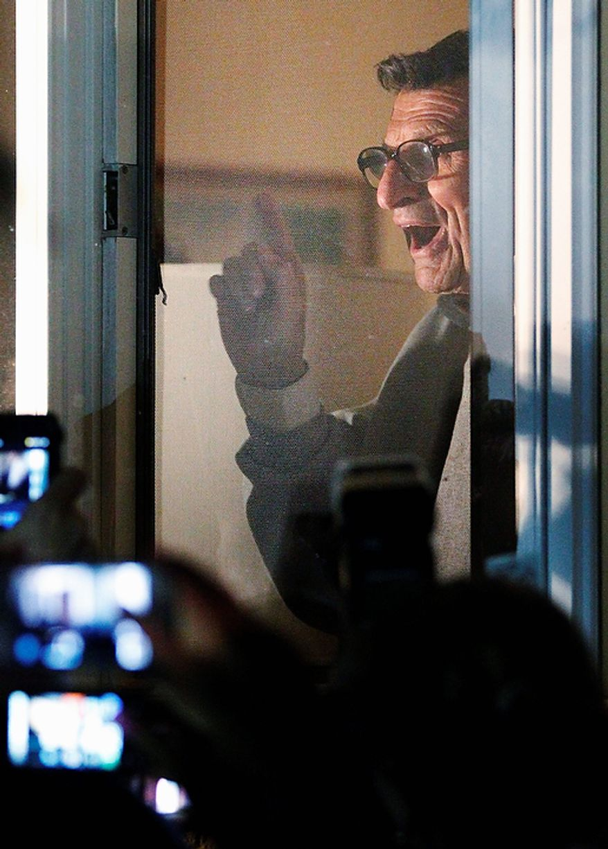 "Penn State football coach Joe Paterno address supporters from a window at his home on Tuesday, Nov. 8, 2011, in State College, Pa. Paterno's support among the Penn State board of trustees was described as ""eroding"" Tuesday, threatening to end the 84-year-old coach's career amid a child sex-abuse scandal involving a former assistant and one-time heir apparent. (AP Photo/Matt Rourke)"