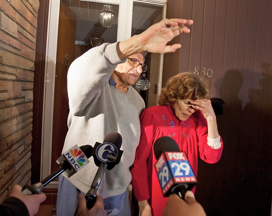 Penn State coach Joe Paterno and his wife, Sue, on the front porch of their house, address students after the Penn State board of trustees announced the resignation of university President Graham Spanier and the firing of Paterno on Wednesday, Nov. 9, 2011. (AP Photo/Joe Hermitt, The Patriot-News)