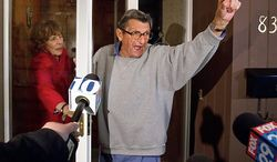 """Ousted Penn State coach Joe Paterno and his wife, Sue, on the front porch of their house, address students on Wednesday, Nov. 9, 2011. The students yelled, """"We are Penn State!"""" to which Paterno responded, """"Yes, we are!""""  (AP Photo/The Patriot-News, Joe Hermitt)"""