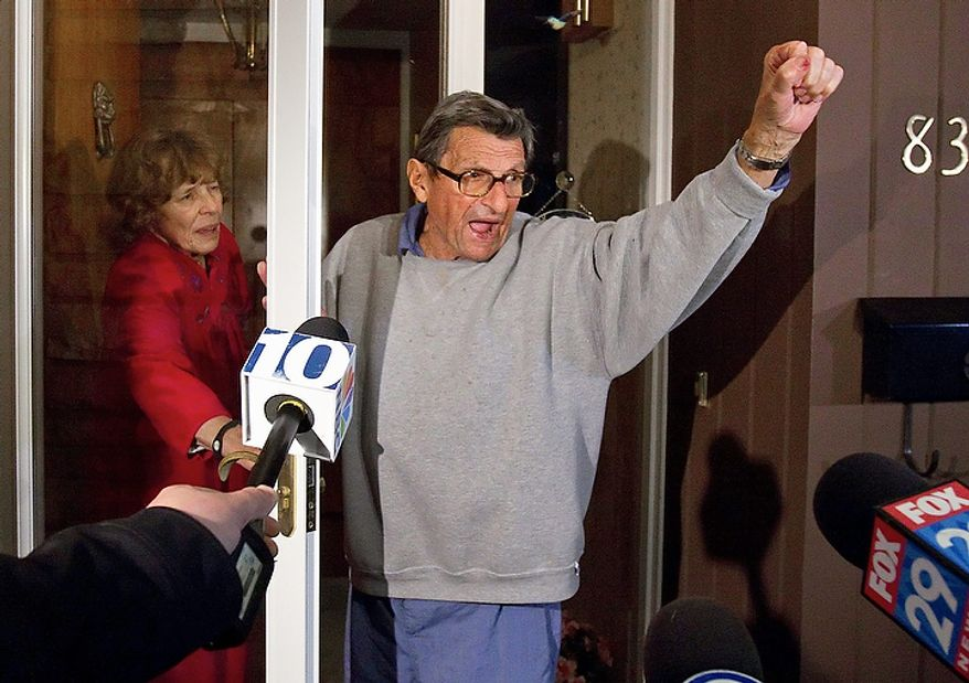 "Ousted Penn State coach Joe Paterno and his wife, Sue, on the front porch of their house, address students on Wednesday, Nov. 9, 2011. The students yelled, ""We are Penn State!"" to which Paterno responded, ""Yes, we are!""  (AP Photo/The Patriot-News, Joe Hermitt)"