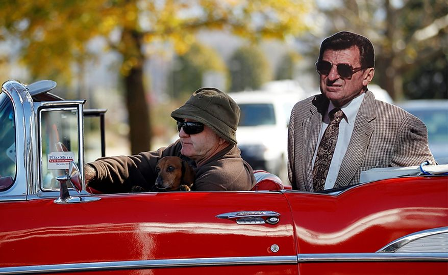 Ed Temple drives around Penn State's Beaver Stadium with a cutout of head football coach Joe Paterno on Tuesday, Nov. 8, 2011, in State College, Pa. (AP Photo/Matt Rourke)