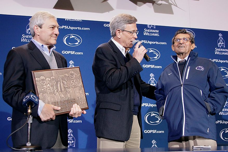 ** FILE ** Penn State President Graham Spanier (left) and Athletic Director Tim Curley (center) present head football coach Joe Paterno with a plaque commemorating Paterno's 409th collegiate win after an NCAA college football game against Illinois in State College, Pa., on Saturday, Oct. 29, 2011. (AP Photo/Gene J. Puskar, File)