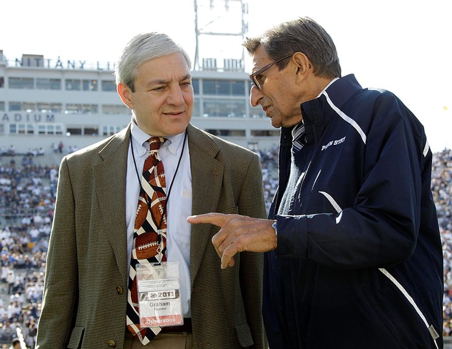 ** FILE ** Penn State President Graham Spanier (left) and head football coach Joe Paterno chat during warmups before an NCAA college football game against Iowa on Saturday, Oct. 8, 2011, in State College, Pa. (AP Photo/Gene Puskar, File)