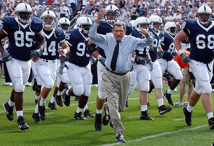 In this Sept. 4, 2004 file photo, Penn State football coach Joe Paterno leads his team onto the field before a game against Akron,  in State College, Pa. Paterno say he plans to retire at the end of the season, his long and illustrious career brought down because he failed to do all he could about an allegation of child sex abuse against a former assistant. (AP Photo /Carolyn Kaster, File)