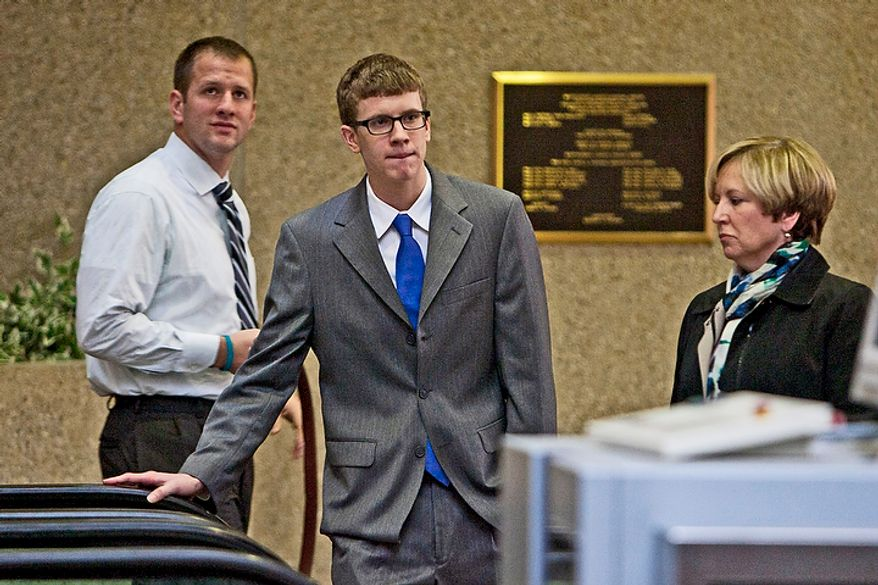 Kevin Coffay, 20, center, with his mother, at right, enters Montgomery County Circuit Court for his plea hearing after being indicted on three counts of vehicular manslaughter and one count of leaving the scene of a fatal crash, in Rockville, Md. on Nov. 10, 2011.(T.J. Kirkpatrick/ The Washington Times)