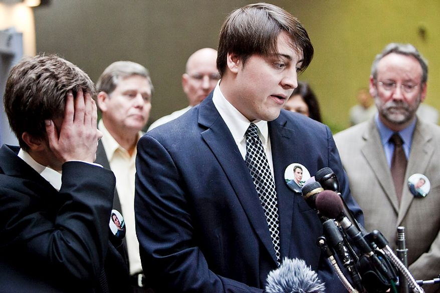 """Jimmy Hoover, 19, left, and Charlie Hoover, center, younger and older brothers, respectively, of John Hoover, a victim killed in crash by Kevin Coffay, speak to the press after Coffay, 20, pled guilty in Montgomery County Circuit Court on three counts of vehicular manslaughter and one count of leaving the scene of a fatal crash, in Rockville, Md. on Nov. 10, 2011. """"When I go home, Johnnie's not going to be there,"""" said Jimmy Hoover, """"I didn't know how much I had until he was gone.""""(T.J. Kirkpatrick/ The Washington Times)"""