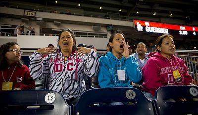 Maria Campos (second from left) is joined by her daughter Milanyela Ramos (second from right) and family friends Marfa Mata (right) and Marfa's 12 year-old daughter Victoria Cabrera (left) as they cheer on her son Washington Nationals catcher Wilson Ramos as he comes to the plate, as the Nationals host the Los Angeles Dodgers at Nationals Park in Washington, DC, Tuesday, September 6, 2011. Mrs. Campos and her daughter, Wilson's sister Milanyela Ramos from Valencia, Venezuela, were recently granted visas to visit her son and to watch him for the first time play in the major leagues. (Rod Lamkey Jr./The Washington Times)