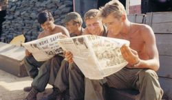 Members of Battery A, 7th Battalion, 8th Artillery reading newspapers in Bien Hoa, Vietnam, April 29, 1970 (Official U.S. Army photo)