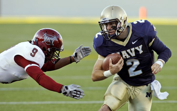 Navy quarterback Kriss Proctor threw for 127 yards and a touchdown against Troy last Saturday. He also added two scores on the ground in the Mids' 42-14 win. (AP Photo/Ann Heisenfelt)