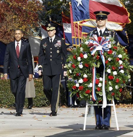 President Barack Obama walks in with Maj. Gen. Michael S. Linnington, Commander of the U.S. Army Military District of Washington, before placing a wreath at the Tomb of the Unknowns during a Veterans Day ceremony at Arlington National Cemetery in Arlington, Va., Friday, Nov. 11, 2011. (AP Photo/Pablo Martinez Monsivais)