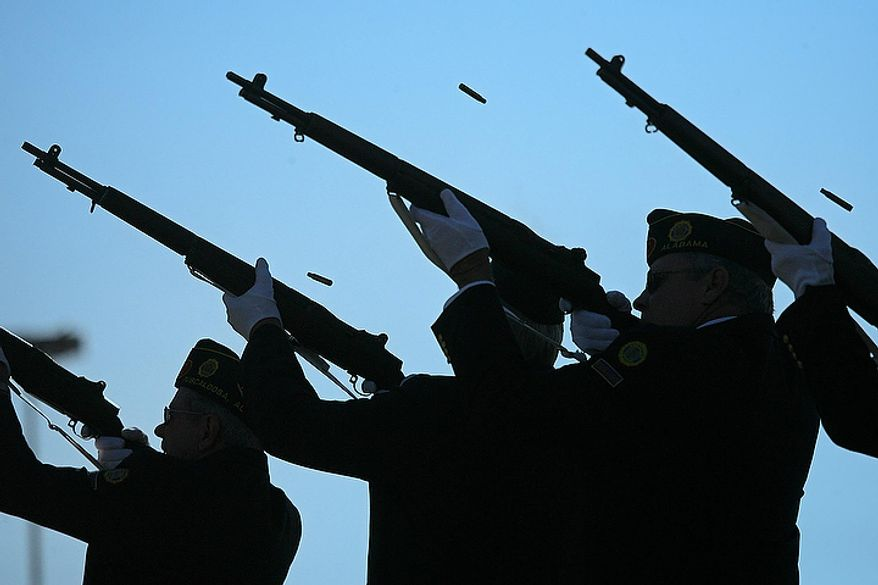 Members of the Honor Guard give a 21 gun salute to close the Veterans Day Program at Veterans Memorial Park in Tuscaloosa, Ala. Friday, Nov. 11, 2011. (AP Photo/The Tuscaloosa News,  Dusty Compton)