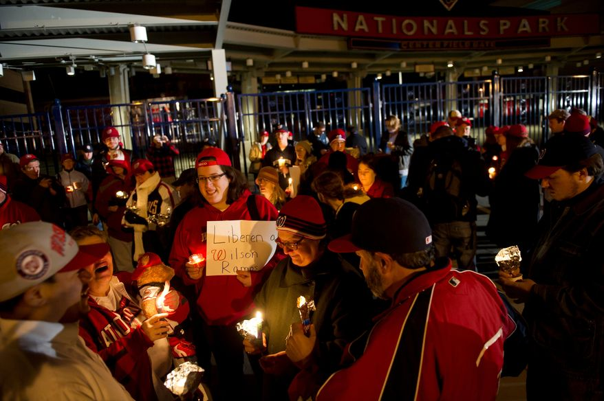 Nationals fans gather in a circle and trade stories during a candlelight vigil for Nationals' rookie catcher Wilson Ramos at Nationals Park in Washington, DC, Friday, November 11, 2011. Ramos was kidnapped by armed gunmen in front of his family home in Venezuela on Wednesday night. (Rod Lamkey Jr. / The Washington Times)